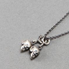 Ugo Cacciatori silver necklace with small skull pendants #ugocacciatori