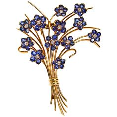 "Van Cleef & Arpels French Flower Sapphire Brooch. A fine vintage 1950s 14k yellow gold French flower bouquet brooch with sapphires. 3 -1/4"" tall. ~7.00cts of sapphires, ~1.20cts diamonds by Van Cleef & Arpels."