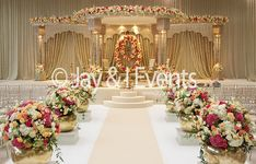 Shreeya Palace - Indian Wedding Decor, cream and gold mandap with florals on top