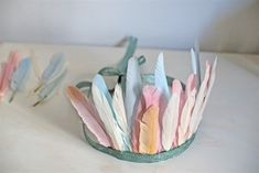 pastel feather headdress.