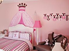 Fit for a princess, a faux bed crown painted on the wall adds height and grandeur to the toddler's new bed. A mix of patterns, from stripes to swirls, energizes the room.