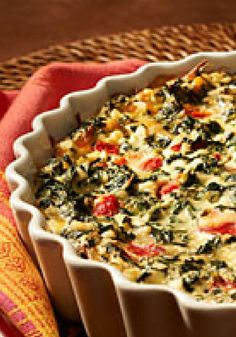 """Quick Italian Spinach Pie — Tangy roasted red peppers kick up the flavor in this """"eggs-cellent"""" spinach pie recipe. Follow Eggland's Best at pinterest.com/egglandsbest/ for more delicious ideas, fun things in the kitchen and other eggciting things!"""