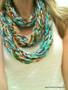 This is my favorite scarf...hands down. I finger knit this with 5 different strands of yarn. (Cream, Brown, Orange, Green and Teal) It measures 41