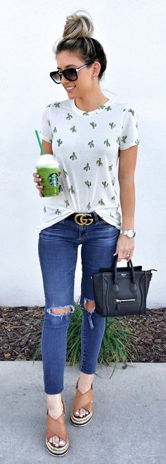 White Printed Tee & Destroyed Skinny Jeans & Black Leather Tote Bag