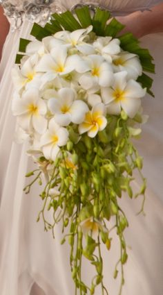 Cascade;  White & yellow frangipanis with white orchid stems