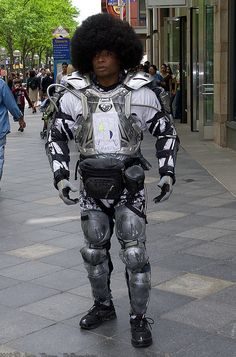 Weird robot dude people now call an Icon - find him on the 16th street mall in Denver. I know I have a picture of us patting each other's afro somewhere....look for that.