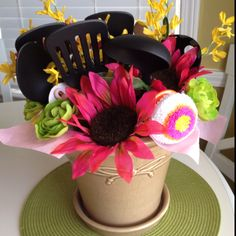 cooking utensils, dish cloths, dish scrubber, an oven mit and the flowers and put in a flower pot. Cute house warming or wedding gift!
