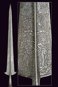 A 16th Century engraved Italian partizan.