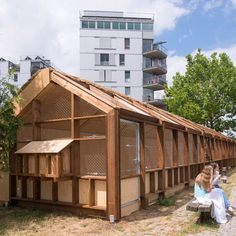 """Guinée*Potin Architectes creates """"footcheball"""" playground inside a thatched shed"""