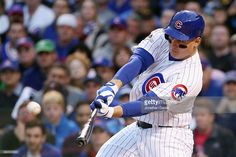 Anthony Rizzo #44 of the Chicago Cubs hits a solo home run in the sixth inning…