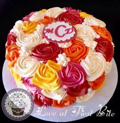 Red, Orange, Yellow, Fushia Rosette Cake