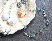 Long sterling silver sea glass necklace with beautiful starfish beads