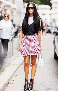 A white tee is layered under a camisole and paired with a gingham mini skirt and Louis Vuitton boots