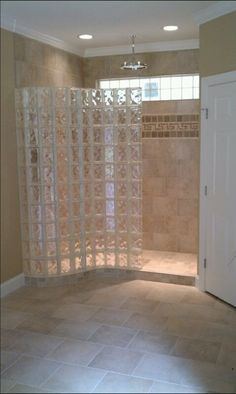 Serpentine glass block wall with a ready for tile shower base