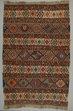 Object Name: Rug Local Name: kilim Place Made: Asia: West Asia, Caucasus, Azerbaijan, Shirvan district Period: Late 19th century Date: 1880 - 1890 Dimensions: L 286 cm x W 179 cm Materials: Wool Techniques: Slit tapestry woven