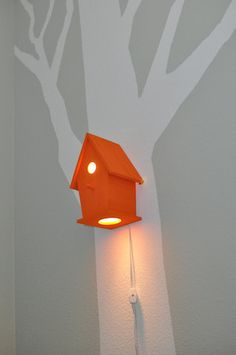 What an awesome night light! Avery in Munchkin Orange Modern Birdhouse Lamp for Baby Nursery.
