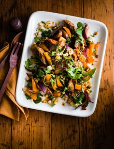A hearty, warming salad of roast sausage and butternut squash with hazelnuts and harissa - it's ready in just 40 minutes!