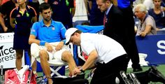 Novak Djokovic getting his foot looked at by a trainer during the finals. Getty Images