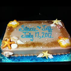 Beach themed shower sheet cake, edible pearls and sugar sand, chocolate seashells and hibiscus flowers. Www.Sugarshowcase.Com www.facebook.com/sugarshowcase