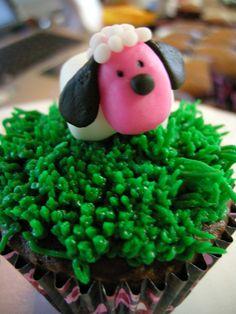 Springtime fondant sheep on a grassy cupcake knoll.  Baa!