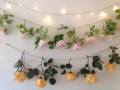 For something a bit more decorative, consider incorporating battery operated string lights with artificial flowers. #decor