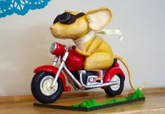 The Mouse and the Motorcycle This cake is based on one of my childhood favourites: Ralph S. Mouse, the star in Beverly Clearly's series of children's books. Here is the original drawing by Rich Werner I used as inspiration: http://www.richwerner.com/?m=20120802. I love his work!  It is made using armature, cake, rice krispy treats, modelling chocolate, fondant and even isomalt. Dominique Ballard