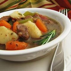 Beef, carrots, potatoes and celery are seasoned with rosemary and parsley in this simple, stovetop stew.