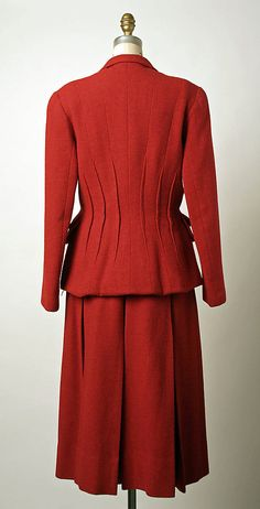 Suit.  Elsa Schiaparelli  (Italian, 1890–1973).  Date: ca. 1952. Culture: French. Medium: wool, rayon. Dimensions: Length at CB (a): 26 3/4 in. (67.9 cm). Length at CB (b): 30 1/4 in. (76.8 cm).