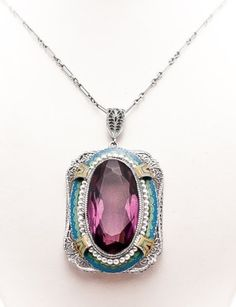 Art deco gorgeous pendant! I love the colors and the setting!