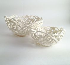 Porcelain Paperclay Filigree Nested  Bowls in white  by lofficina    Paperclay is a mix of porcelain and paper pulp. Paper in the clay changes the molecular structure of the clay body. The paper burns out of the clay in the kiln after about 300° and then the clay is as normal.