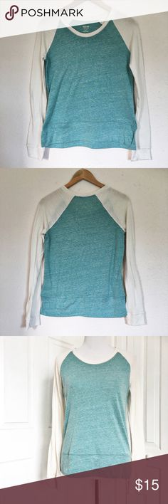 """Mossimo Long Sleeve Raglan Top Teal blue top with cream colored sleeves make up the Mossimo Raglan style top.  Top is in good condition and very soft being made of 53% polyester 33% cotton and 12% rayonne.  Measurements laid flat: bust 19"""" and length from top of shoulder to hem 26"""".  Top could accommodate a size M. Mossimo Supply Co Tops Tees - Long Sleeve"""