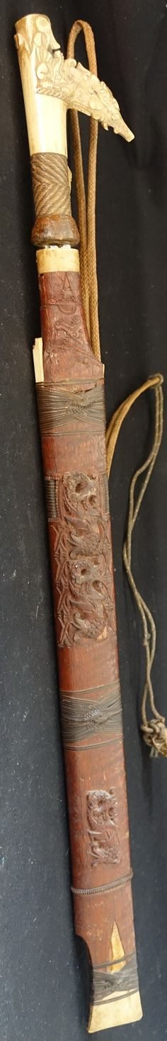 Mandau Dayak Hunting Sword from Borneo/Kalimantan. Ornate carving on sheath, grip carved from antlers horn