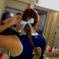 @Nadia Playter Softball hair! Fishtail braid and a big bow...necessity for this summer :)