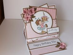 (Ref:H35) 15cm x 15cm easel card. Stamps by LOTV, Rosie with cake  sentiment stamp 'just to say'. Background papers by Nitwit 'Fine Linen'. Dies used, La La Land 'Berry Flourish', Dienamics 'Rolled Daisy', Marianne 'Rolled Roses', Doohickey 'Lace Die'.