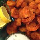 Buffalo Shrimp  2 C all-purpose flour  2 T. Creole-style seasoning  1 T garlic powder  1 T ground cayenne pepper  1 tsp onion powder  1 tsp freshly ground pepper  1 lb large shrimp,peeled deveined with tails attached  4 C oil4frying   BUFFALO SAUCE   4 cl (butter substitute for frying)