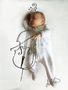 Mom turns her infant son's nap positions into awesome activities with a pen