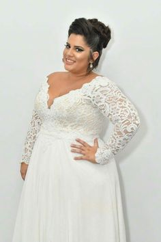 real plus size bride in Prada lace plus size wedding gown with a second over skirt from Studio Levana