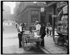 Clam Vendor at Mulberry Bend in New York City, 1900 (Click the photo and slide the Green Fade Bar for Then/Now views.)