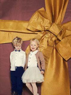 Sparkle pink tights co-ordinate with a lurex cardigan for Mini a Ture kidswear Christmas dressing while a white shirt is a versatile accompaniment