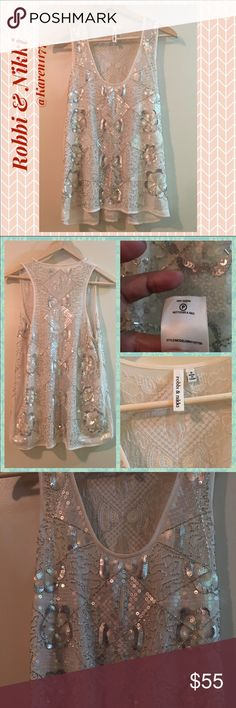 Just In✨Robbi & Nikki Sequin Sheer Ivory Top✨ NWOT Sheer Ivory Sleeveless Top with beads & Sequin Embellishment. Just Stunning, picture does no, Justice. 100% Polyester. No flaws, everything on its place. Lmk if you need measurements. Thank you!‼️Best prices when Bundled‼️Reasonable Offers Accepted‼️ Robbi & Nikki  Tops Blouses