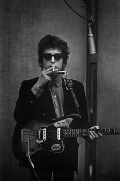 "Bob Dylan - June 1965. ""Fender Jaguar, check. Harmonica, check. Burning cigarette, check. Cool shades, check. Let's get this recording session started!"""