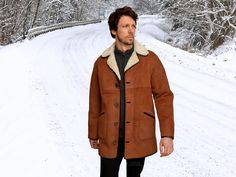 Higgs Leathers  Kent (men's Tan and White Shearling coats)  (£795) A Timeless Classic Style!  Extra soft, lightweight, 3/4 length men's Tan with Cream wool Icelandic Lambskin coats.  Rever collar can be fastened high in the neck, straight cut body with side splits and easy-cut sleeves with optional turn back cuffs. Can be worn comfortably over thicker winter clothing without feeling restricted.  A really comfortable classic design that never dates, one of our favourites!