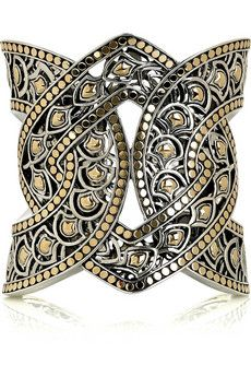 18-karat gold and sterling silver knot-style cuff with dotted trim. John Hardy cuff is handmade, has cutout detailing, a dragon filigree motif on the inside and an opening at back to slip on.