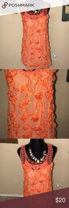 Beautiful floral orange top Beautiful floral orange top. Sleeveless with inside lining Lost Tops Tunics