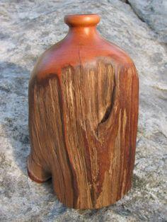Plum dried flower vase  by John DeWitt