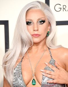 Lady Gaga has a nip slip on the red carpet at the 2015 Grammy Awards