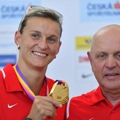 Czech athlete Barbora Spotakova shows off her IAAF gold medal