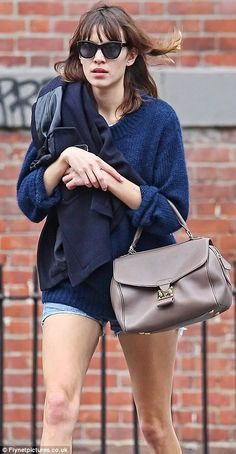 Nothing is so ordinary about the bag Alexa Chung is carrying. Louis Vuitton, Les Extraordinaires! Cuir Orfevre Neo Speedy
