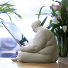 Venus of Cupertino is a sculptural docking station inspired by the curvaceous forms and symbolism of ancient Venus figurines. Each Venus is hand-cast in museum quality resin, and is a fully functional iPad docking station.  Her hands gently guide any second, third, or fourth generation iPad onto a charger inconspicuously located in her midriff.  A USB cable emerges from a number of points under the sculpture and fits any USB port or Apple power adaptor for syncing or charging. Venus ships…