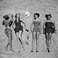 fun in the sun. i wish all girls wore beautiful vintage bathing suits still instead of the trashy two pieces I see all the time.